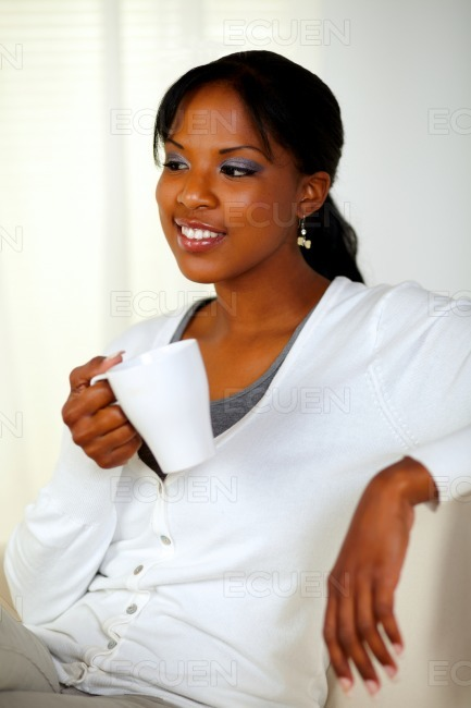 Relaxed young woman holding a white mug stock photo