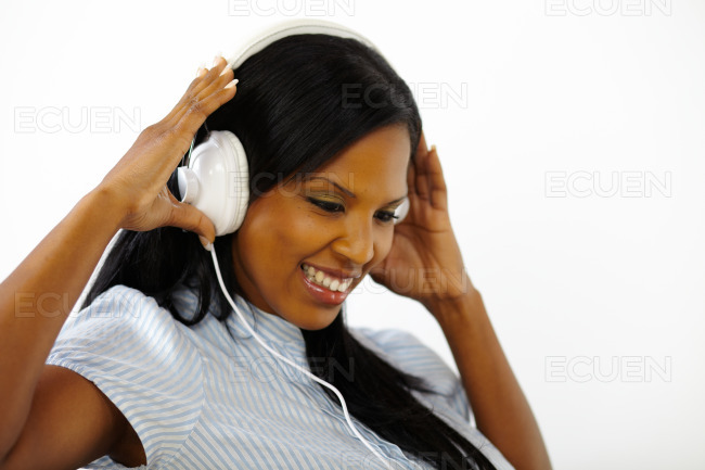 Relaxed young woman listening to music stock photo