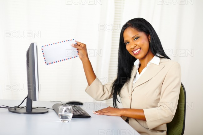 Secretary sending a e-mail stock photo