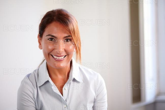 Senior business woman smiling at you stock photo