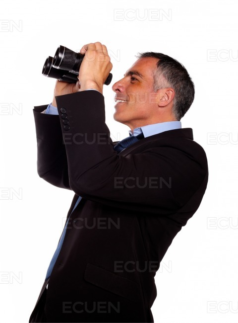 Senior executive looking up through binocular stock photo