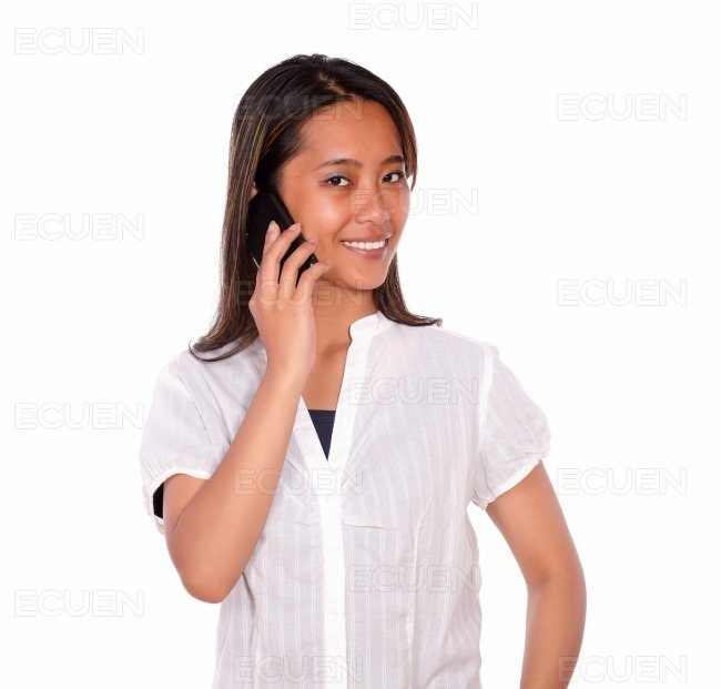 Smiling asiatic young woman speaking on cellphone stock photo
