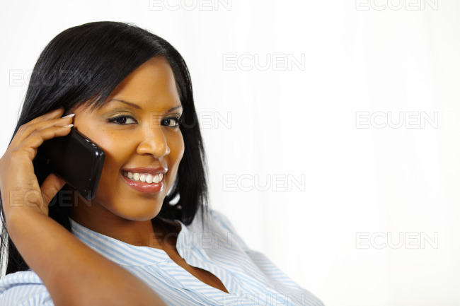 Smiling pretty young woman on mobile phone stock photo