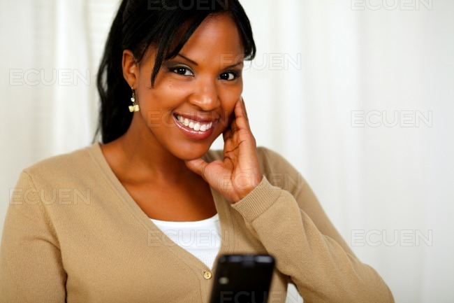 Smiling woman looking at you sending a message stock photo