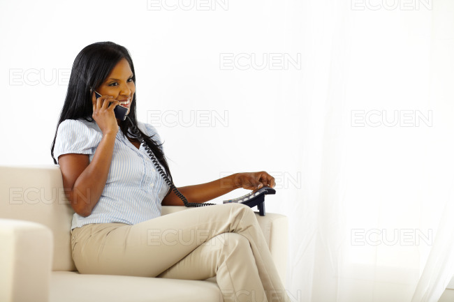 Smiling young lady speaking on phone stock photo