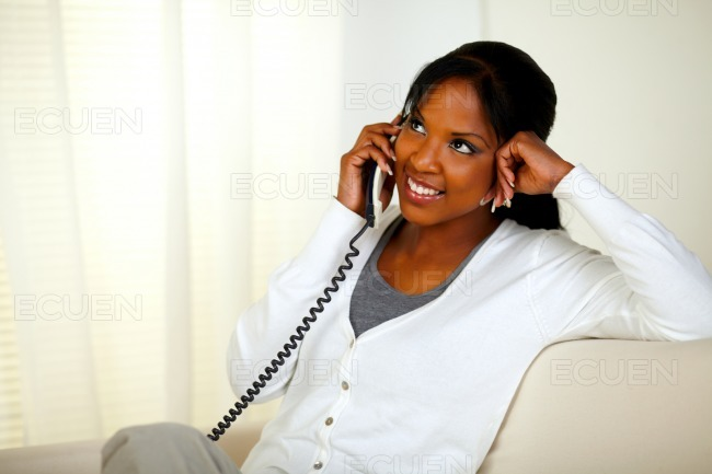 Smiling young woman talking on phone stock photo