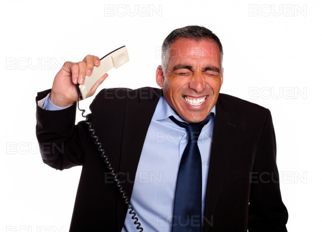 Stressed executive listening on phone stock photo