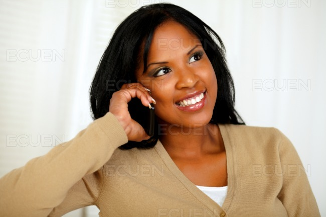 Stylish young woman conversing on cellphone stock photo