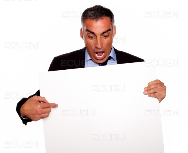 Surprised manager looking and pointing a card stock photo