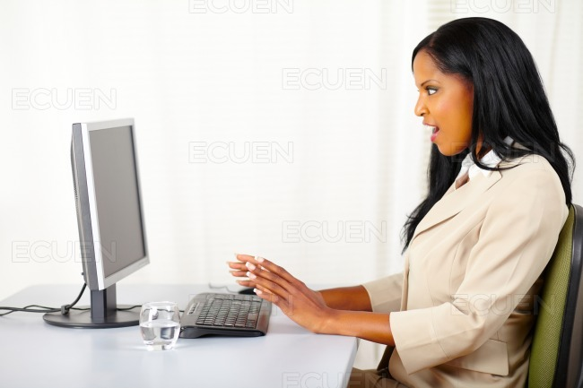 Surprised young woman at work stock photo