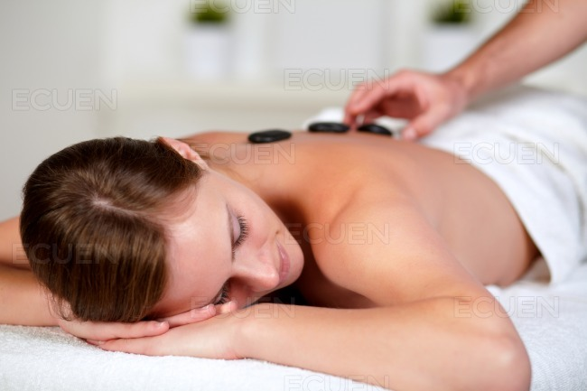 Tired young female relaxing at a spa stock photo