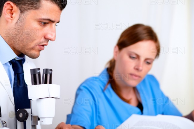 Two colleagues working at laboratory stock photo