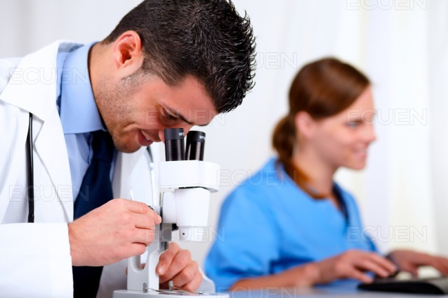Two medical colleagues working at laboratory stock photo