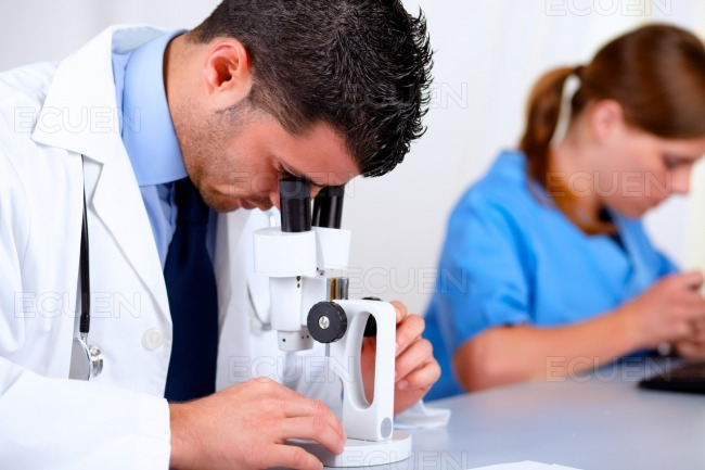 Two medical doctors working at laboratory stock photo