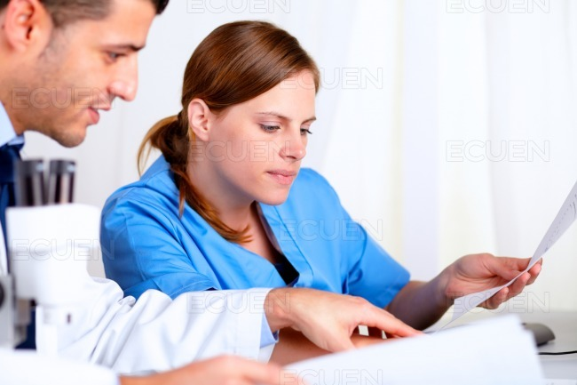Two medical scientific looking to some documents stock photo