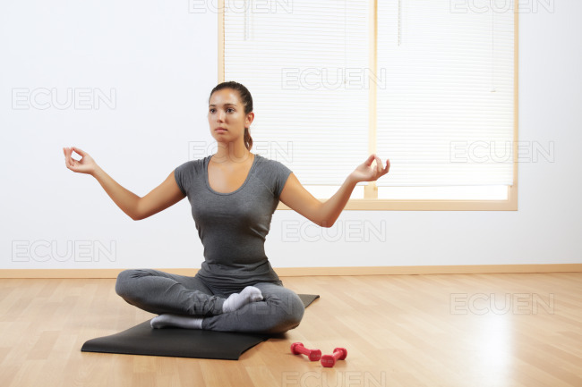 Woman doing yoga at home stock photo