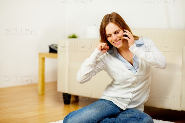 Woman on mobile phone celebrating a victory stock photo