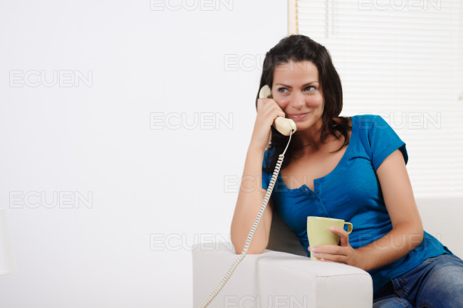 Woman on the phone and smiling stock photo