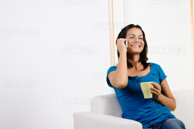Woman talking on a mobile phone stock photo