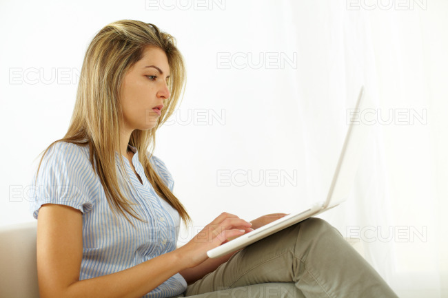 Woman using a laptop stock photo