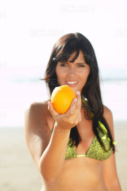 Women offering you an orange stock photo