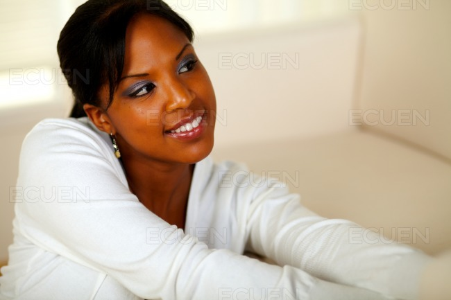 Young afro-American woman looking to her left stock photo