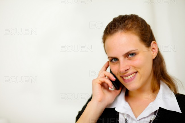 Young beautiful businesswoman at cellphone stock photo