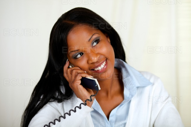 Young black woman conversing on phone stock photo