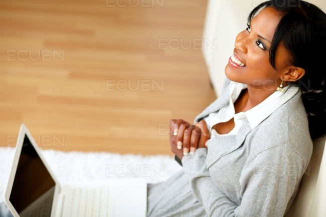 Young black woman sitting at home on the floor stock photo