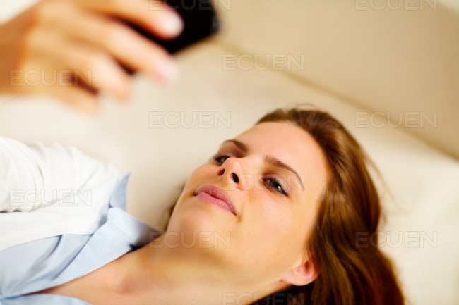 Young blond female using a mobile phone stock photo