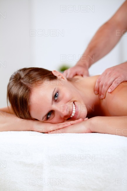 Young blonde girl relaxing at a spa stock photo