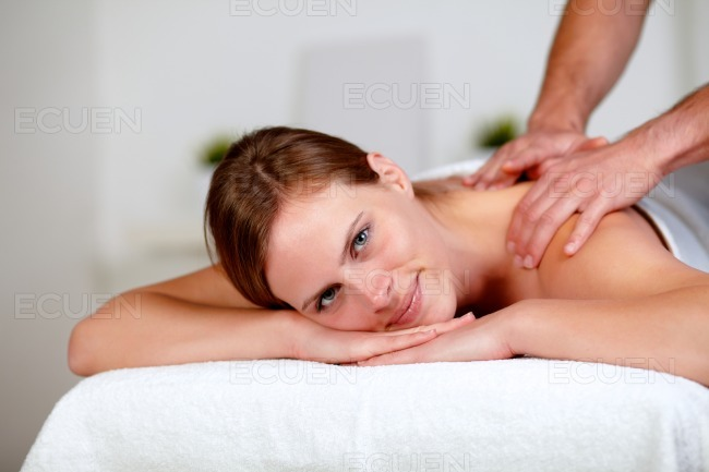 Young blonde woman relaxing at a spa stock photo