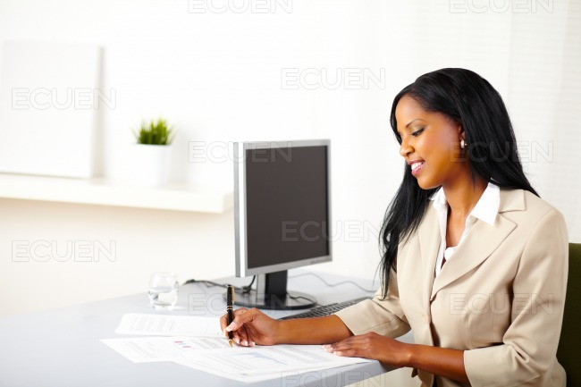 Young business female working on documents stock photo