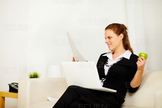 Young business woman working at home stock photo