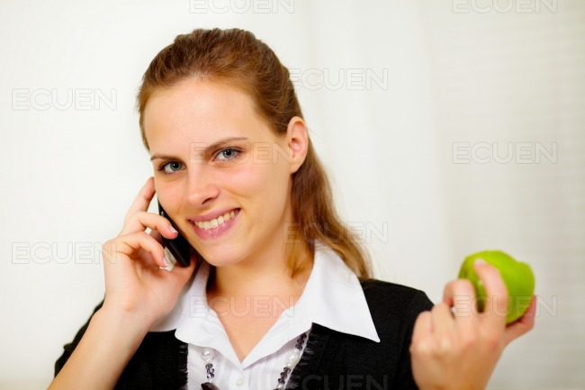 Young businesswoman at mobile phone stock photo