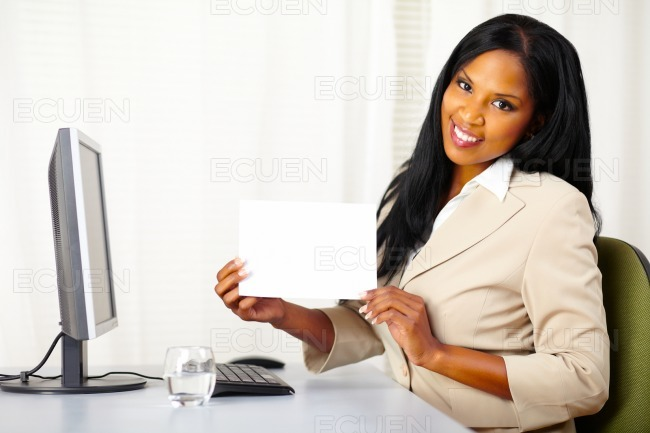 Young businesswoman showing a white card stock photo