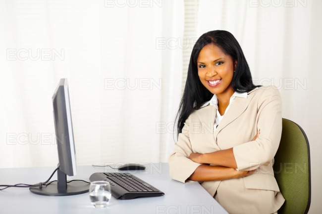 Young confident businesswoman at work stock photo