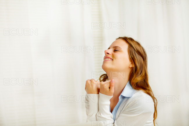 Young cute woman celebrating a victory stock photo