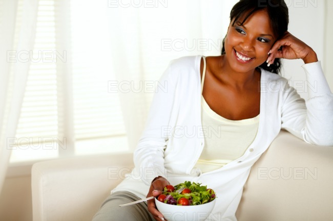 Young female eating healthy salad lunch stock photo
