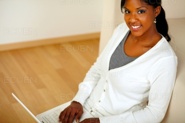 Young female looking at you browsing the Internet stock photo