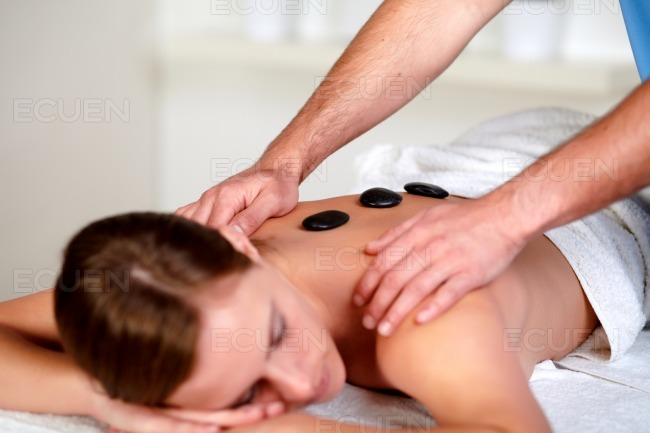 Young female relaxing at a day spa stock photo