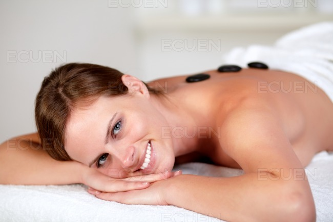 Young female smiling and relaxing at spa stock photo