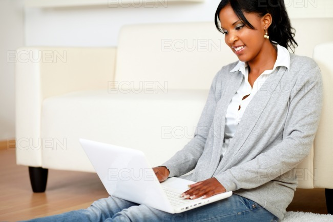 Young girl smiling and browsing the Internet stock photo