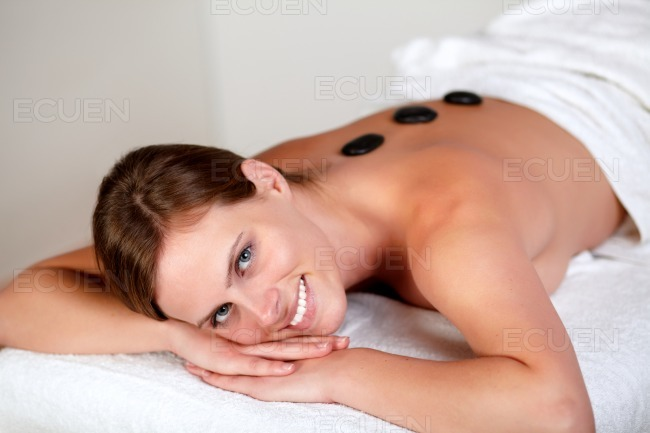 Young girl smiling and relaxing at spa stock photo