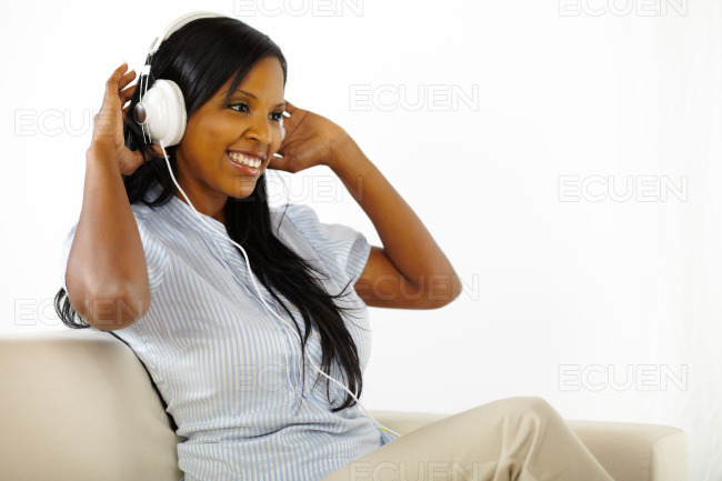 Young lady listening to music and having fun stock photo
