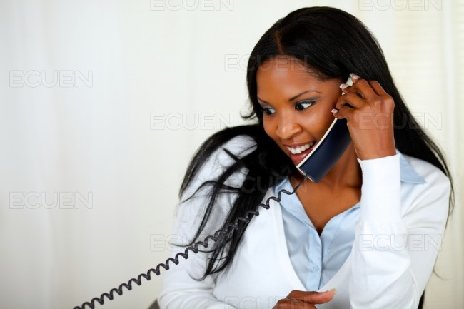 Young lovely girl conversing on phone stock photo