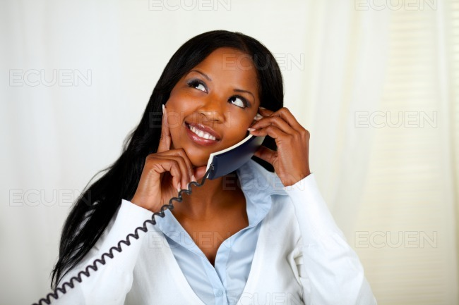 Young lovely woman conversing on phone stock photo