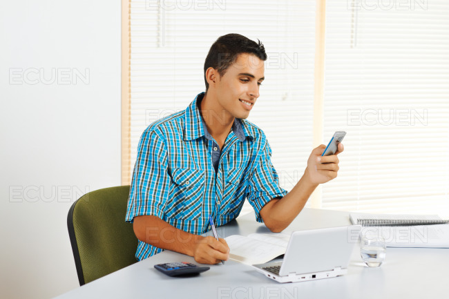 Young man receiving a call stock photo