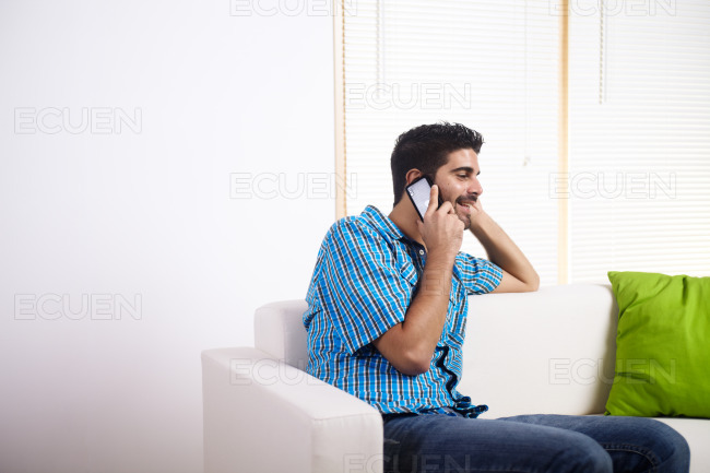 Young man talking on the mobile phone stock photo