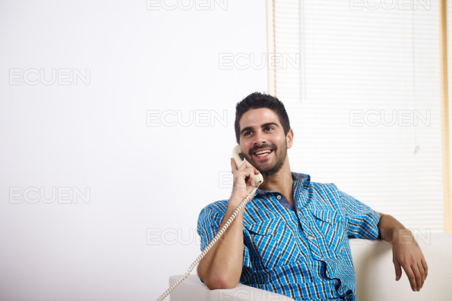 Young man talking on the phone stock photo